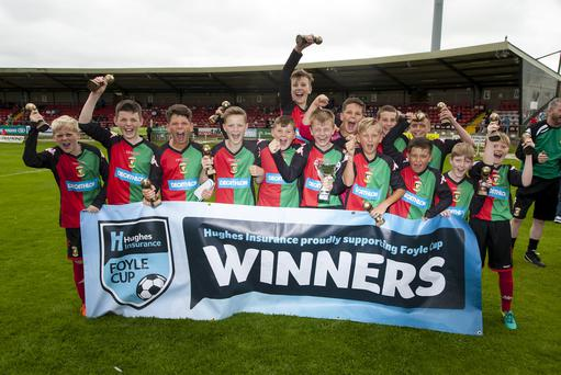 Three and easy: Glentoran's Under-12s celebrate their latest success at the Foyle Cup