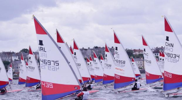 Plotting a course: sailors take to the water in Belfast Lough in yesterday's Topper World Championships amid perfect conditions off Ballyholme