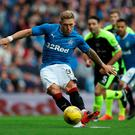 Net gain: Martyn Waghorn puts Rangers ahead with an early penalty, the first of two goals the striker scored in a comfortable victory over Stranraer, to book a last 16 spot in the Betfred Cup