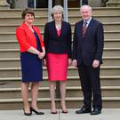 Prime Minister Theresa May with First Minister Arlene Foster and Deputy First Minister Martin McGuinness at Stormont Castle, Belfast, during her first official visit to Northern Ireland yesterday