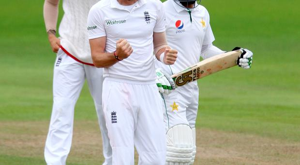 Over and out: James Anderson celebrates after taking Pakistan's Azhar Ali's wicket on what proved to be the final day of the Test which England won by 330 runs.