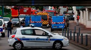 French police vehicles and firemen arrive at the scene of a hostage-taking at a church in Saint-Etienne-du-Rouvray, northern France, on July 26, 2016 that left the priest dead. / AFP PHOTO / CHARLY TRIBALLEAUCHARLY TRIBALLEAU/AFP/Getty Images