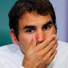 Sidelined: Roger Federer will miss the Rio Olympics and US Open