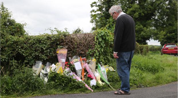 Flowers left at the scene where Michelle McStravick and Lorraine Clyde died in a road accident