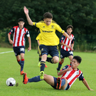 Super spectacle: Middlesbrough's Cain Sykes has his path blocked by Jossue Cordova in the 6-1 defeat to Chivas Guadalajara in the SuperCupNI at Clough yesterday