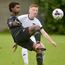 Touch tight: Armagh's Alberto Balde takes on Gavin O'Kane of Tyrone