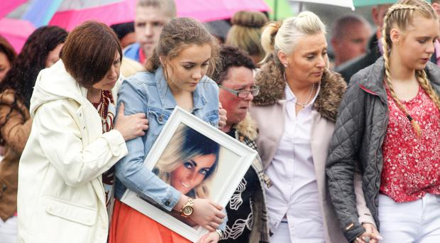 Cliodhan Maire McStravick (Orange Dress) carries a picture of her mum as the funeral of Michelle McStravick takes place at St MacNissi's church in Randalstown on July 28 2016 ( Photo by Kevin Scott / Belfast Telegraph )
