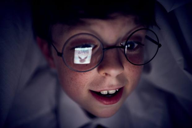 Toby L'Estrange, a ten year old speed reading prodigy, who has been challenged by Amazon to post the first review of Harry Potter and The Cursed Child (parts 1 and 2), shortly after its midnight release this Sunday. Mikael Buck/Amazon/PA Wire