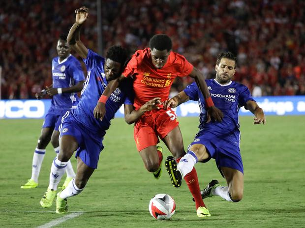 Liverpool's Ovie Ejaria, center, is defended by Chelsea's Cesc Fabregas, right, and Ola Aina during the first half of an International Champions Cup soccer match at the Rose Bowl, Wednesday, July 27, 2016, in Pasadena, Calif. (AP Photo/Jae C. Hong)