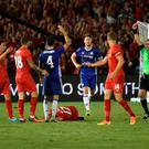 Chelsea midfielder Cesc Fabregas (3rd L) receives a red card after fouling Liverpool player Ragnar Klavan (on ground) during their International Champions Cup (ICC) game at the Rose Bowl Stadium in Pasadena, California on July 27, 2016. Chelsea won 1-0. / AFP PHOTO / Mark RalstonMARK RALSTON/AFP/Getty Images