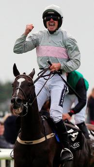Warrior spirit: Ruby Walsh after riding Clondaw Warrior to victory in the big Guinness Galway Hurdle yesterday