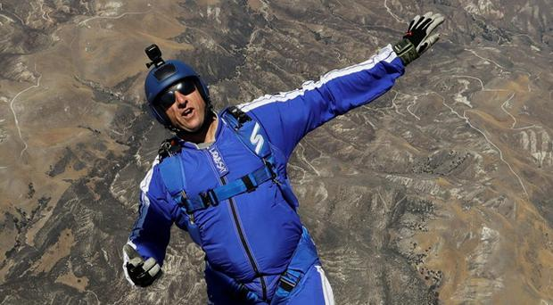 In this Monday, July 25, 2016 photo, skydiver Luke Aikins jumps from a helicopter during his training in Simi Valley, Calif. (AP Photo/Jae C. Hong, File)