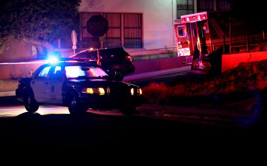 San Diego police and other law enforcement stage near the scene of a shooting of two San Diego police officers near South 38th Street in San Diego Thursday night, July 28, 2016. (John Gastaldo/The San Diego Union-Tribune via AP)