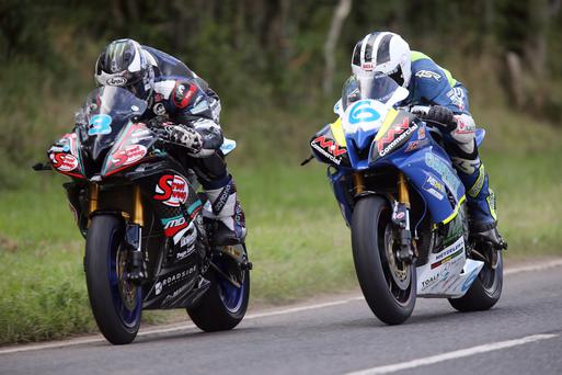 Family affair: William Dunlop (above right) passes his brother Michael on his way to winning the Supersport race at Armoy Road Races last night