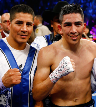 All in the family: Big brother Antonio celebrates with Leo Santa Cruz after the latter's victory over Jose Cayetano