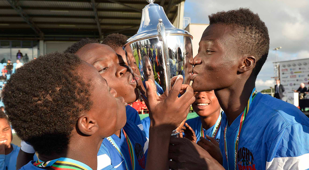 Sealed with a kiss: Right to Dream players celebrate their back-to-back SuperCup NI success at the Ballymena Showground