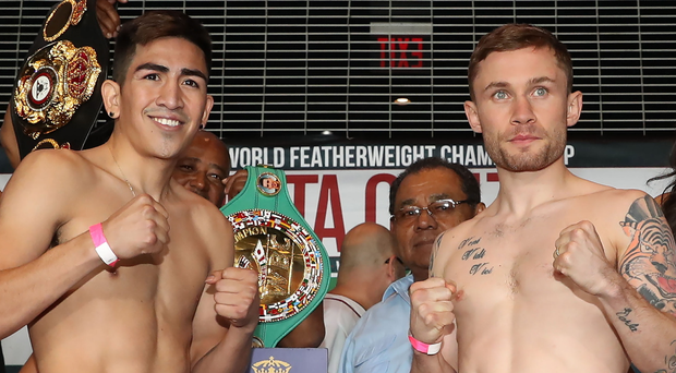 It takes two: Carl Frampton and Leo Santa Cruz get up close at yesterday's weigh-in ahead of their big showdown