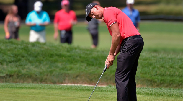 On course: Open champion Henrik Stenson on his way to a 67 yesterday at the USPGA