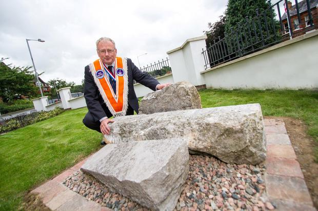 Past Worshipful Master of Boyne Obelisk LOL 1690, Gordon McKinley, with the Boyne obelisk stones which are now on permanent display at the Museum of Orange Heritage in Belfast. Photo by Graham Curry