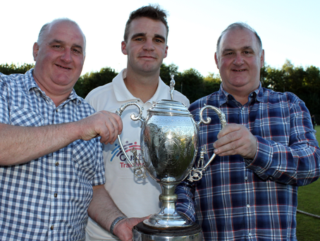 Class act: James, Andrew and James McBrine celebrate Donemana's cup success