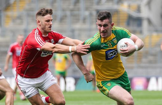 Prize fighter: Donegal hero Patrick McBrearty is challenged by Eoin Cadogan