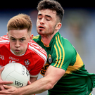 Keeping it tight: Derry's Eoghan Bradley holds off a challenge from David Naughton of Kerry
