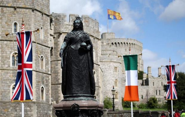 Identity: The Union flag and the Irish tricolour, emblems of Britishness and Irishness respectively, sway in the breeze outside Windsor Castle