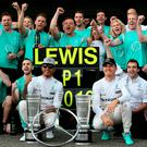 Number one: Lewis Hamilton celebrates with his Mercedes GP team including Nico Rosberg