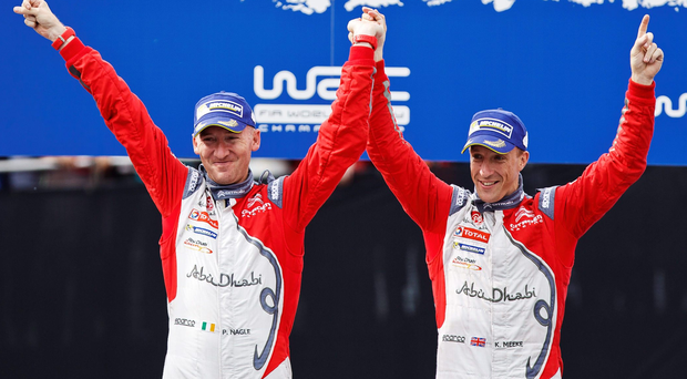 Top gear: Kris Meeke (right) and Irish co-driver Paul Nagle come home first at the Finland Rally