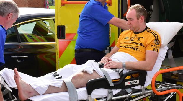 Injury: Augher player Aidan Cassidy on way to hospital after sustaining a broken ankle and damaged hand against Galbally