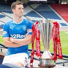 Back in the big time: Gers skipper Lee Wallace gets a look at the Premiership title ahead of his side's top-flight return