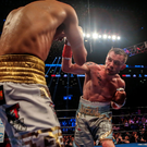 Master at work: Carl Frampton lands a blow on Leo Santa Cruz during his World featherweight title victory in New York
