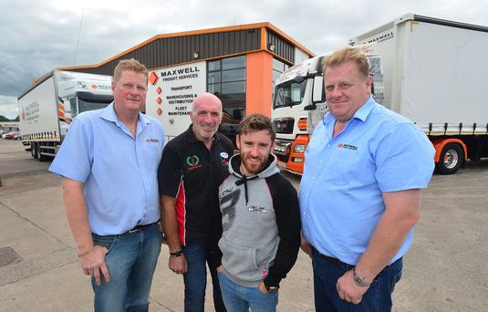 Maxwell Freight Services confirm sponsorship of Supertwins race at MCE Ulster Grand Prix. L-R: Tommy Maxwell, Noel Johnston, Clerk of the Course at the MCE UGP, Lee Johnston and Terry Maxwell.