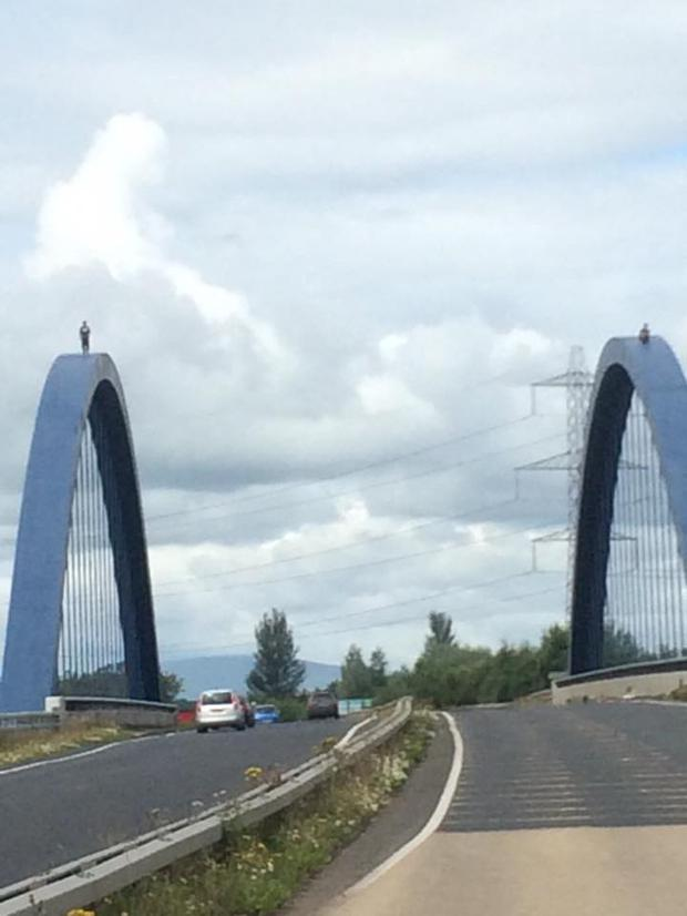 Two people standing on Toome bridge. Picture: Damien Doyle.