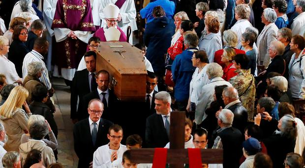 Pallbearers carry the coffin of murdered priest Jacques Hamel