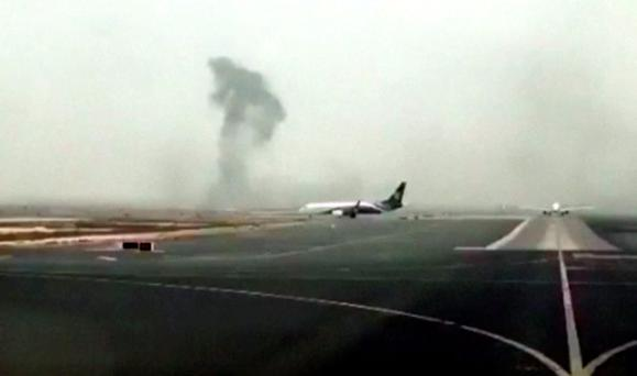 This image made from video shows smoke rising after an Emirates flight crash landed at Dubai International Airport on Wednesday, Aug. 3, 2016. The plane at right was unaffected Dubai-based airline Emirates has confirmed that there were no fatalities on a flight from India that crash-landed . The carrier says Äúall passengers and crew are accounted for and safe.Äù It raised the number of people onboard the flight to 300, saying there were 282 passengers, 18 crew.(Hayen Ayari via AP)
