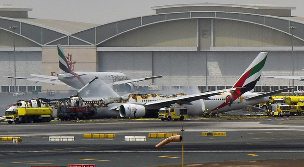 The remnants of the Emirates airliner on the runway in Dubai