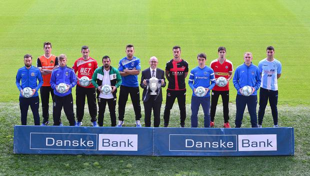 Members of the Premiership teams pictured at the National Football Stadium at Windsor Park in Belfast with Danske Bank's chief executive, Kevin Kingston holding the Gibson Cup at the launch of the league. Picture By: Arthur Allison.