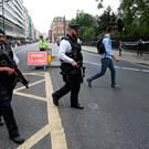 Armed police personnel walk past a crime scene in London's Russell Square on August 4, 2016, following a knife attack in which one woman was killed and five others injured. A woman was killed and five people injured in a knife attack in central London Wednesday which police said they are investigating for possible terrorist links. A 19-year-old man was arrested in Russell Square, in the city centre, which was cordoned off after the attack as police swarmed the area. / AFP PHOTO / JUSTIN TALLISJUSTIN TALLIS/AFP/Getty Images