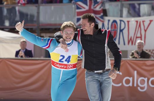 Taron Egerton and Hugh Jackman in Eddie the Eagle. Photo: PA Photo/Larry Horricks/Lionsgate