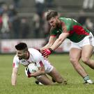 Ready to renew rivalry: Tyrone's Tiernan McCann and Aidan O'Shea of Mayo will meet at Croke Park in the All-Ireland quarter-finals