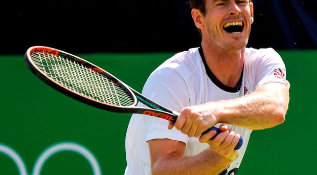 Net gains: champion Andy Murray, who will carry the Great Britain flag at the opening ceremony, gears up for his first round clash with Viktor Troicki in Rio