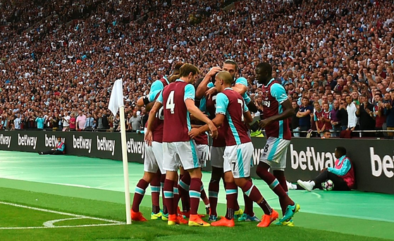 Home and hosed: Celebrations from players and fans alike following the Cheikhou Kouyate goal that put West Ham into an aggregate lead last night