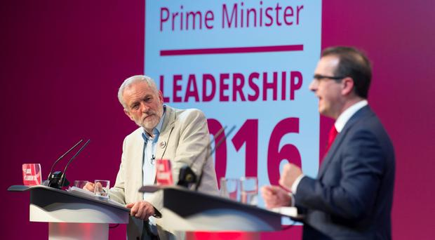 Jeremy Corbyn MP looks on as Owen Smith MP speaks at the first Labour leadership debate at the All Nations Centre on August 4, 2016 in Cardiff, Wales. The result of the Labour leadership contest between Jeremy Corbyn MP and Owen Smith MP is due to be announced on September 24. (Photo by Matthew Horwood/Getty Images)