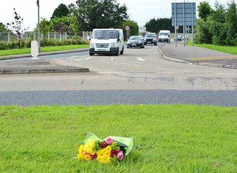 Floral tribute left at the scene of the crash. Picture By: Pacemaker Press.