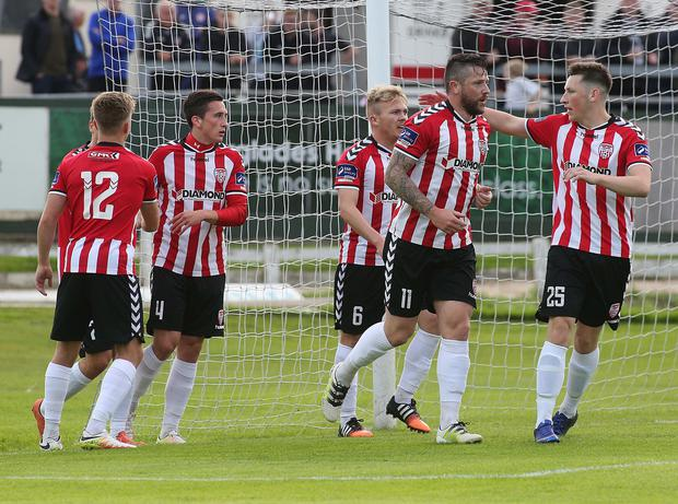 Get in: Derry's Rory Patterson (centre) celebrates his goal
