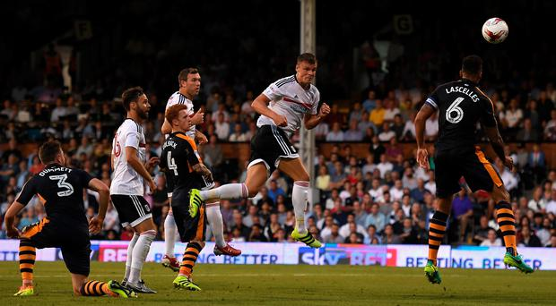 Decisive moment: Matt Smith headed in Fulham's winner