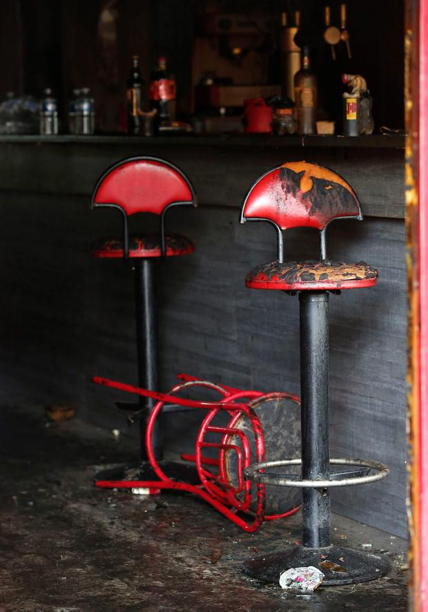 Burned seats are pictures in the bar where a fire broke in Rouen, western France, Saturday Aug.6, 2016. (AP Photo/Kamil Zihnioglu)