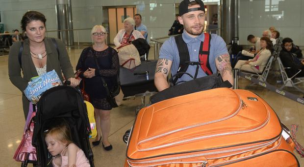 Carl Frampton pictured as he arrives at Dublin Airport after his WBA world championship fight against Leo Sanyta Cruz in New York. Photograph: Stephen Hamilton/PressEye