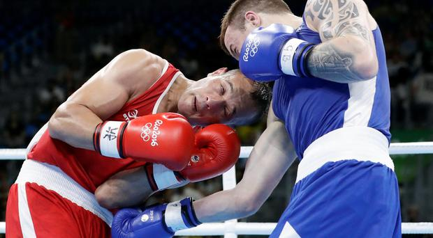 Ireland's Steven Donnelly, left, fights Algeria's Zohir Kedache during a men's welterweight 69-kg boxing match at the 2016 Summer Olympics in Rio de Janeiro, Brazil, Sunday, Aug. 7, 2016. (AP Photo/Frank Franklin II)